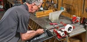 Gentleman regriping a golf club in the Golf & Ski repair shop