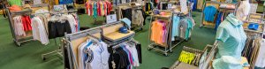 lots of women's golf clothing on racks in a retail store