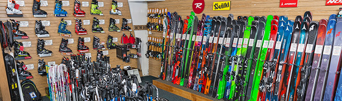 View of the product wall with ski boots and skis along the wall