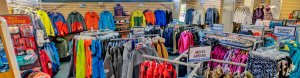 lots of winter clothes on racks at a retail store