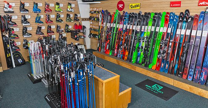 Wall of skis and ski poles and ski boots