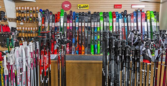 Wall of skis and ski poles
