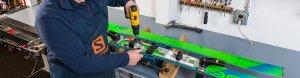 Employee installing ski binding in the repair shop